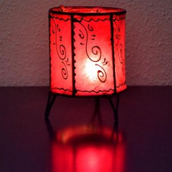 Cup form candleholder of leather painted with henna