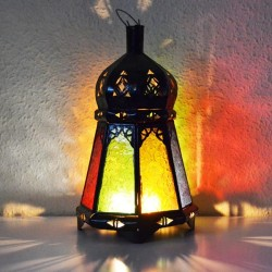 Candle lantern of colored glass and pierced iron