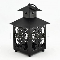 Openwork iron lantern of a square house shape