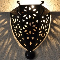 Openworked iron sconce of medieval style with handles
